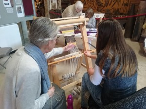 Teaching a visitor weaving on a warp-weighted loom